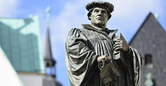 How do Protestant and Catholic beliefs differ?