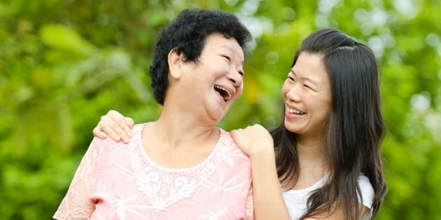Mom and Adult Daughter Laughing Header