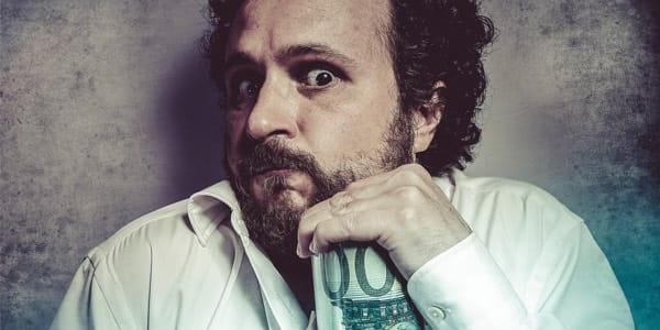 Stingy Man Holding Money Header