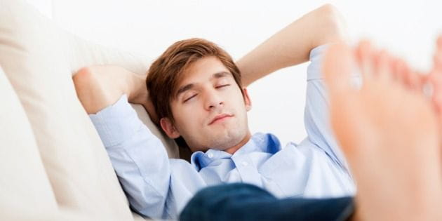 Young Man Asleep on the Couch