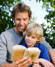 Father and son reading Bible