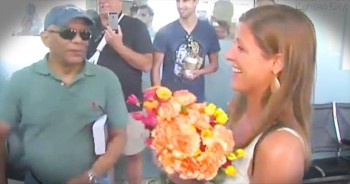 Complete Strangers Started Handing This Woman Flowers And She Had No Idea What Was Going On. But Just Wait!