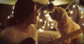 Girl Sings 'Christmas Time Is Here' While Adorable Dog Watches