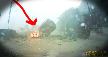 A Giant Boulder Nearly Crushes Car In Mudslide