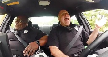 Police Officers' Hilarious Duet Is Caught On Dash Cam