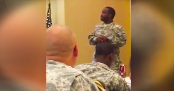 Military Man Sings The National Anthem In Front Of Class