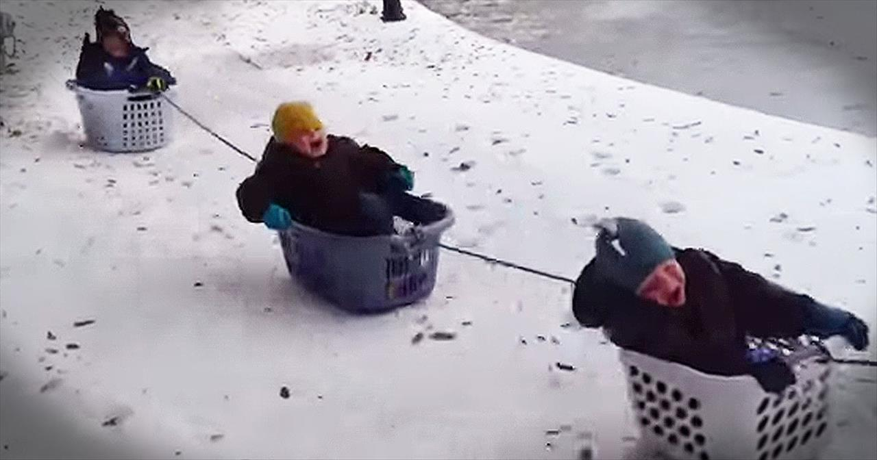 Dad Takes Kids On Amazing Laundry Basket Sleigh Ride
