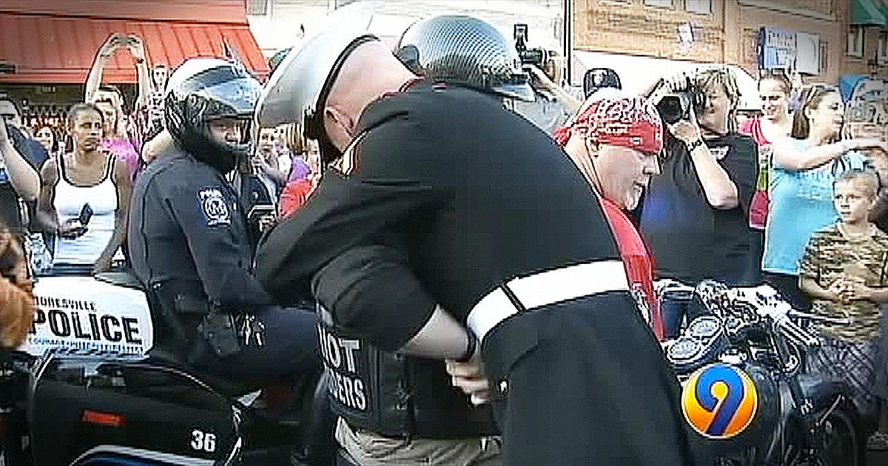 Marine And Wounded Vet Share Emotional Hug During Parade