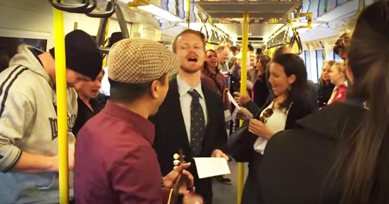Stranger Starts 'Somewhere Over The Rainbow' Sing-A-Long On Train