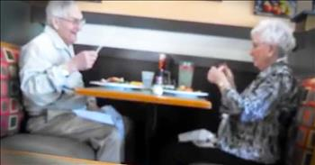 Elderly Couple Blow Straws At Each Other During Dinner