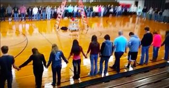 Entire School Prays Together In Gymnasium