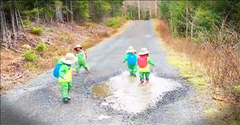 Tiny Kids Playing In A Big Puddle Will Make Your Day