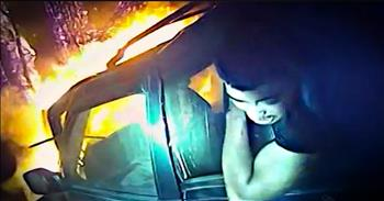 Bodycam Footage Of A Police Officer Rescuing A Man From A Burning Car
