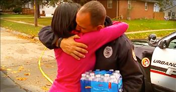 Woman And Police Officer Embrace After Shootings