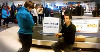 Man With Guitar Proposes At The Airport