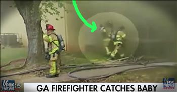 Firefighter Catches A Baby Thrown From A Burning Building