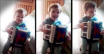 Tiny Tot Thinks He Is An Accordion Master