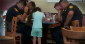 8-Year-Old Girl Prays With Police Officers