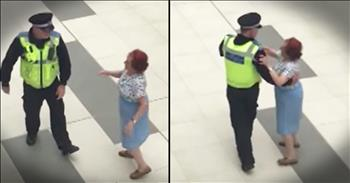 Mall Cop And Woman Waltz Around Shopping Center