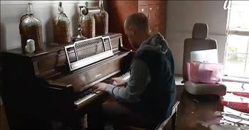Musician Plays Piano In Flooded Home