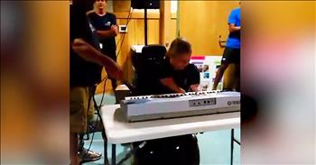 16-Year-Old Without Limbs Plays 'Somewhere Over The Rainbow'