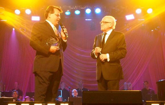 Clarke Beasley presents NQC Lifetime Achievement award to Lari Goss