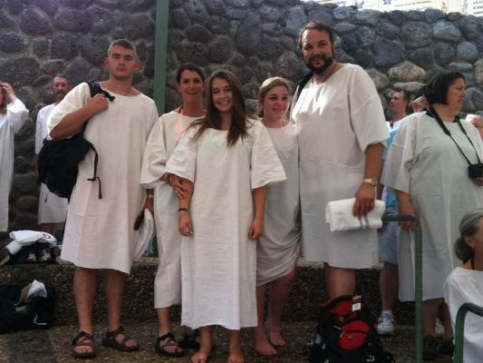 Ben's family (Jacob, Mindy, Kyra, Cameron) waiting to be baptized at the Jordan River