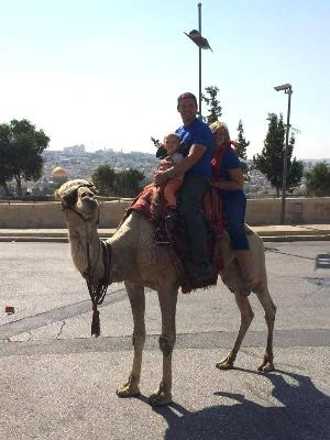 Sonya Isaacs Yeary riding a camel with husband Jimmy and little Ayden