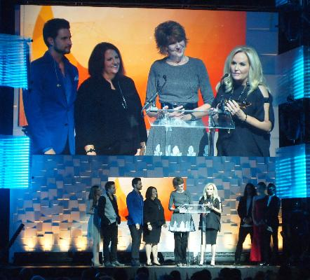 """KPNR and songwriter Kenna West accept their award for Southern Gospel Song of the Year (""""Revival"""")"""