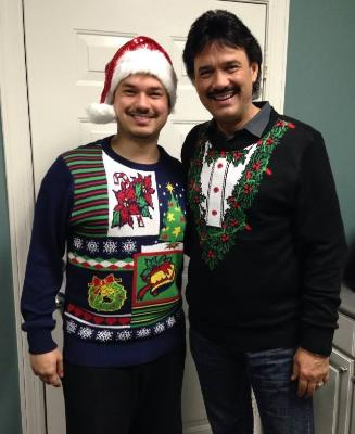 Ivan Parker and his son Josh show off their ugly Christmas sweaters