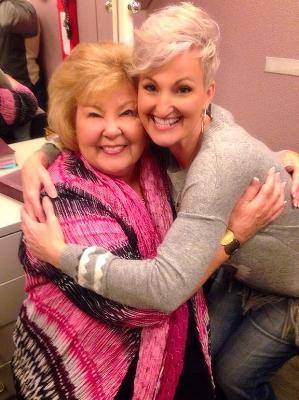 Gloria Gaither and Joyce Martin Sanders share a squeeze