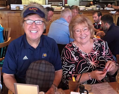 """Bill sports a """"hairy hat"""" posing with Gloria during a meal at Twisted Fish Co. Alaskan Grill"""
