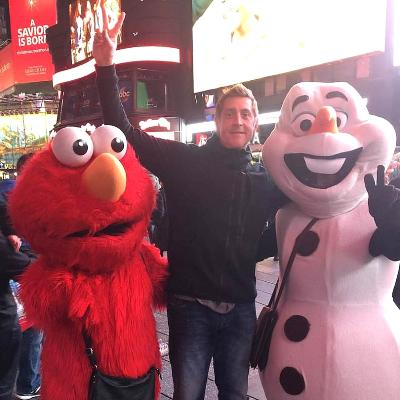 …and Ernie meets Elmo and Olaf at the Macy's Thanksgiving Day Parade!