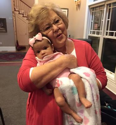 At the Homecoming artists' retreat, Gloria snuggles Todd Suttles' baby daughter