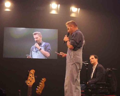 Rory Feek onstage with country artist Bradley Walker